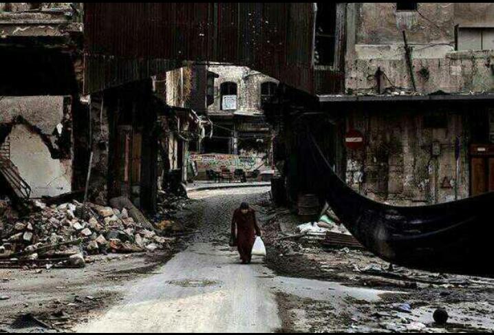"""فاز مصور إيطالي بميدالية روبرت كابا الذهبية عن صورة في سوريا وعنوانها \""""مقاومة حت"""