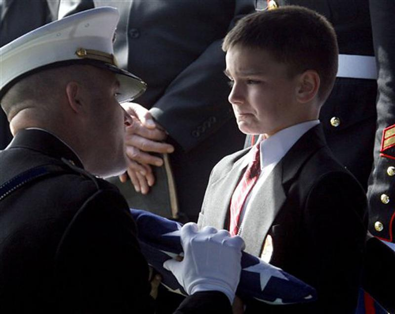 "Who Says War is fine ""Eight-year-old Christian Golczynski accepts the flag for his father\"""