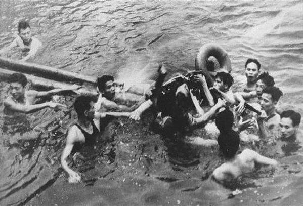Airman being captured by Vietnamese civilians in Truc Bach Lake in 1967. The airman is John McCain