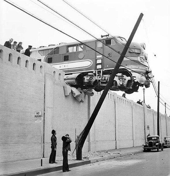 A locomotive hangs over Aliso Street after running off the end of rails at Union Station. LA, 1948