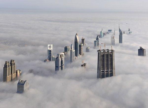 Skyscrapers shrouded in fog, Dubai.