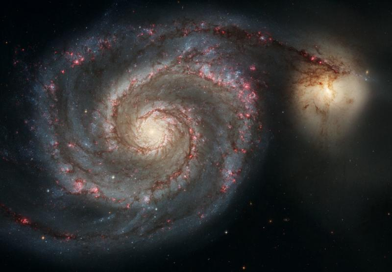 Out of this whirl: The Whirlpool Galaxy (M51) and companion galaxy - space