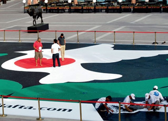 #دبي مجدداً في موسوعة جينيس بأكبر لوحة فسيفساء في العالم لحمامة سلام - صورة 2