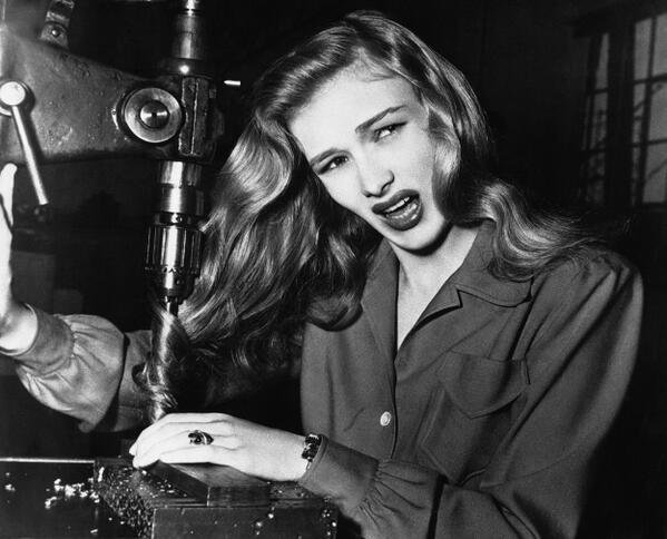 Actress Veronica Lake illustrates what can happen to women war workers who wear their hair long in a factory. 1943
