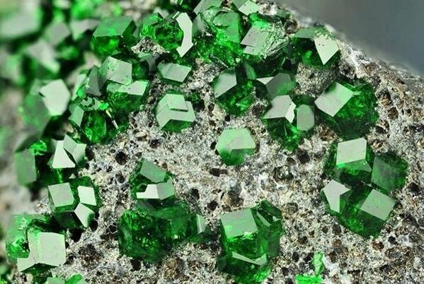 This is Uvarovite, a rare mineral often confused with Emerald for its deep green colour