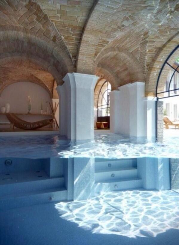 Indoor to outdoor glass pool
