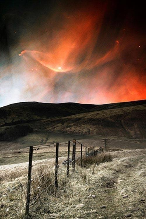 Orange aurora borealis above Iceland