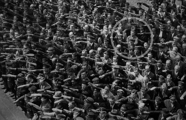 August Landmesser, a German who was engaged to a Jewish woman, refused to do the Nazi salute. Hamburg, 1936