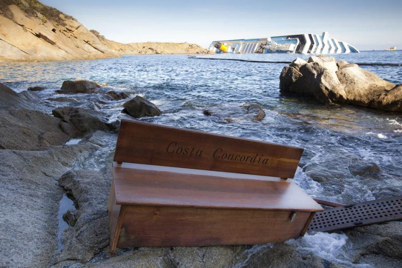 A bench engraved with the name of the grounded Costa Concordia cruise ship
