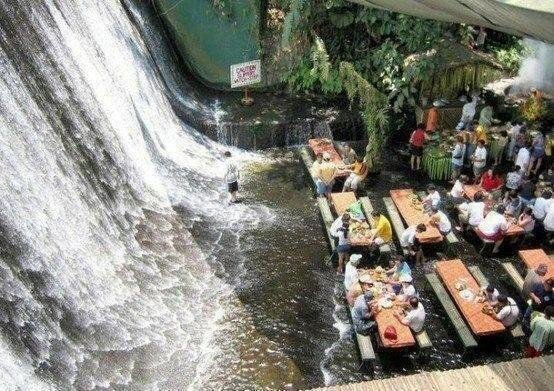 There's a restaurant where you eat barefoot in water from a waterfall. Located in Phillipine