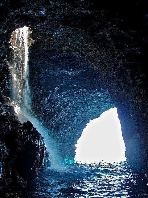 Sea cave waterfall Hawaii