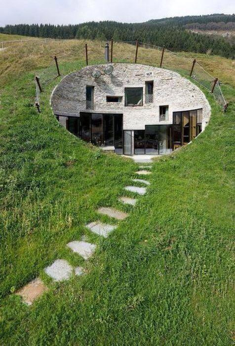 A modern house carved into a hill