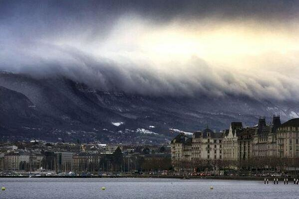 An optical illusion, clouds rolling in over the mountains looks like a Tsunami, Geneva, Switzerland