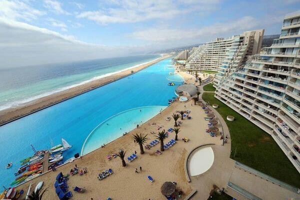 The worlds largest pool covers 20 acres, holds 66 million gallons of water and has a 115 foot deep e
