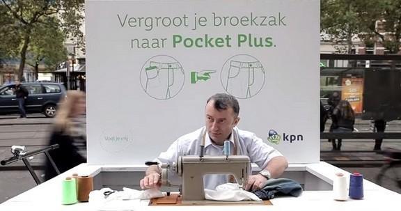 رجل يفتح كشك صغير امام متاجر #Apple في المانيا لتعديل جيب بناطيل مستخدمي #IPhone6