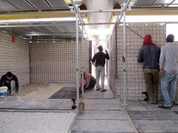 بيوت كاملة قليلة التكلفة تبنى بالحصى في مخيمات اللاجئين في الزعتري - صورة 2