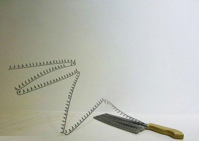 فنان ينحت مجسمات على شفرة السكين #غرد_بصورة -صورة 2