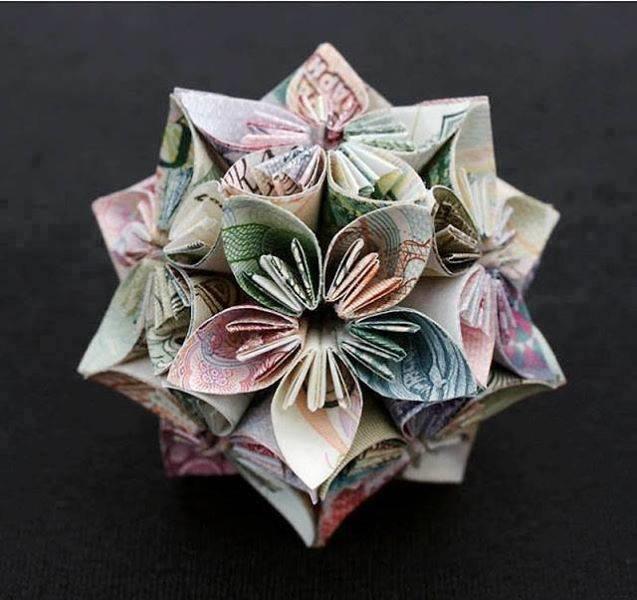 أجمل الأشكال الهندسية المكونة من المال ومن العملة الورقية #غرد_بصورة -صورة 2