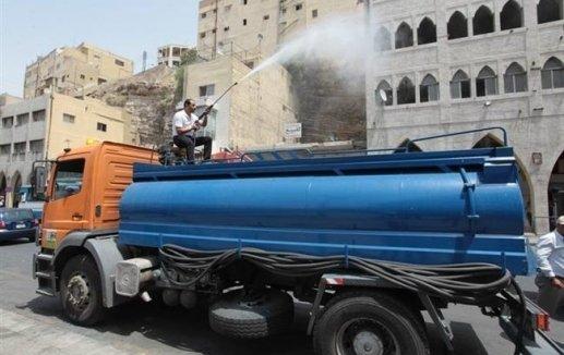 رش المياه على عدد من شوارع عمان الرئيسية #عمان