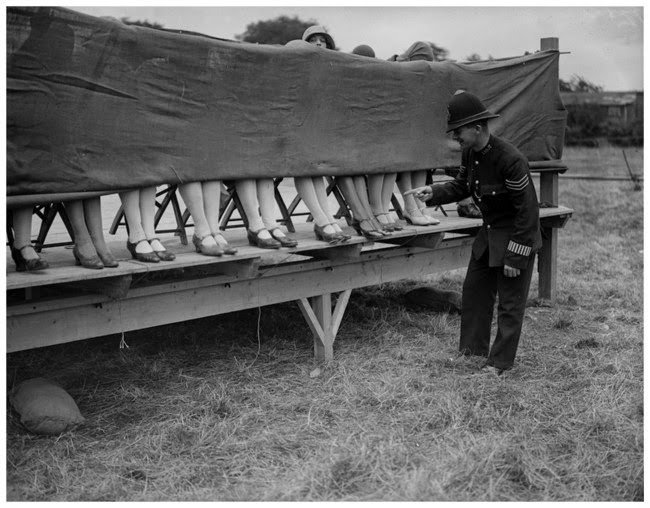 In 1930, a policeman judges an ankle contest #History