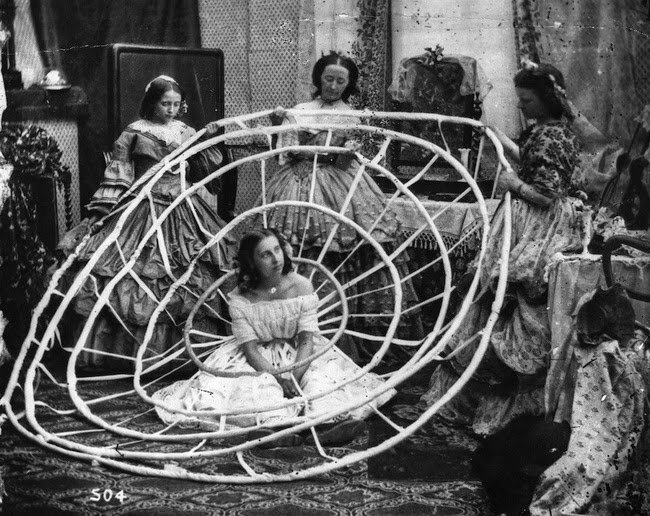 A woman waits for the hoops of her crinoline to be finished in a London dress shop in 1860 #History