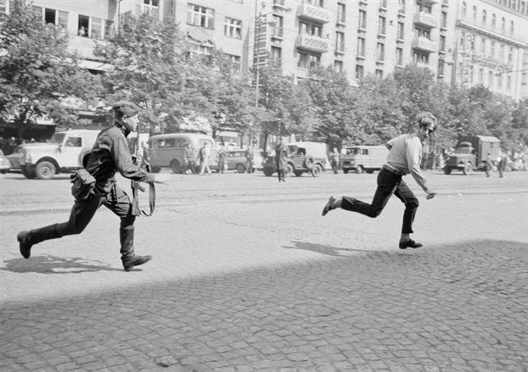 During the Prague Spring in 1968, a Soviet soldier chases a young Czech man who was throwing rocks at a tank #History