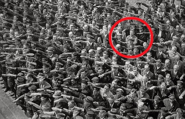A lone man refusing to do the Nazi Salut, 1936 #History